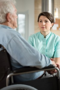 Disabled man talking with nurse